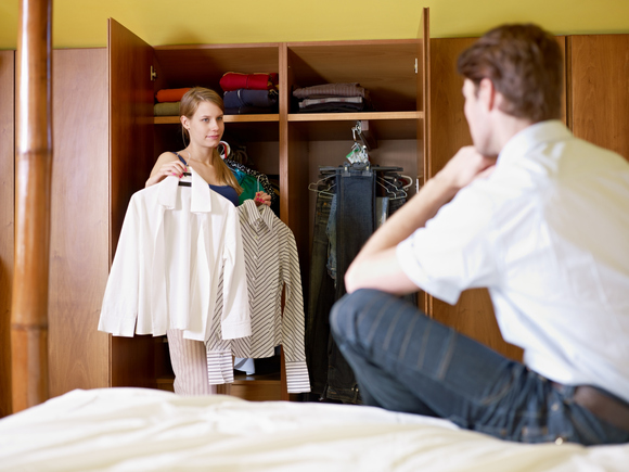woman_man_choosing_clothing_app-100584659-large